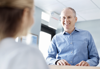 Patient being checked in using NextGen Office cloud EMR scheduler